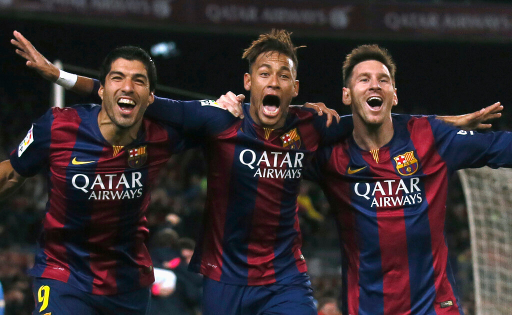 Barcelona's Luis Suarez, Neymar and Lionel Messi celebrate a goal against Atletico Madrid during their Spanish First Division soccer match at Camp Nou stadium in Barcelona